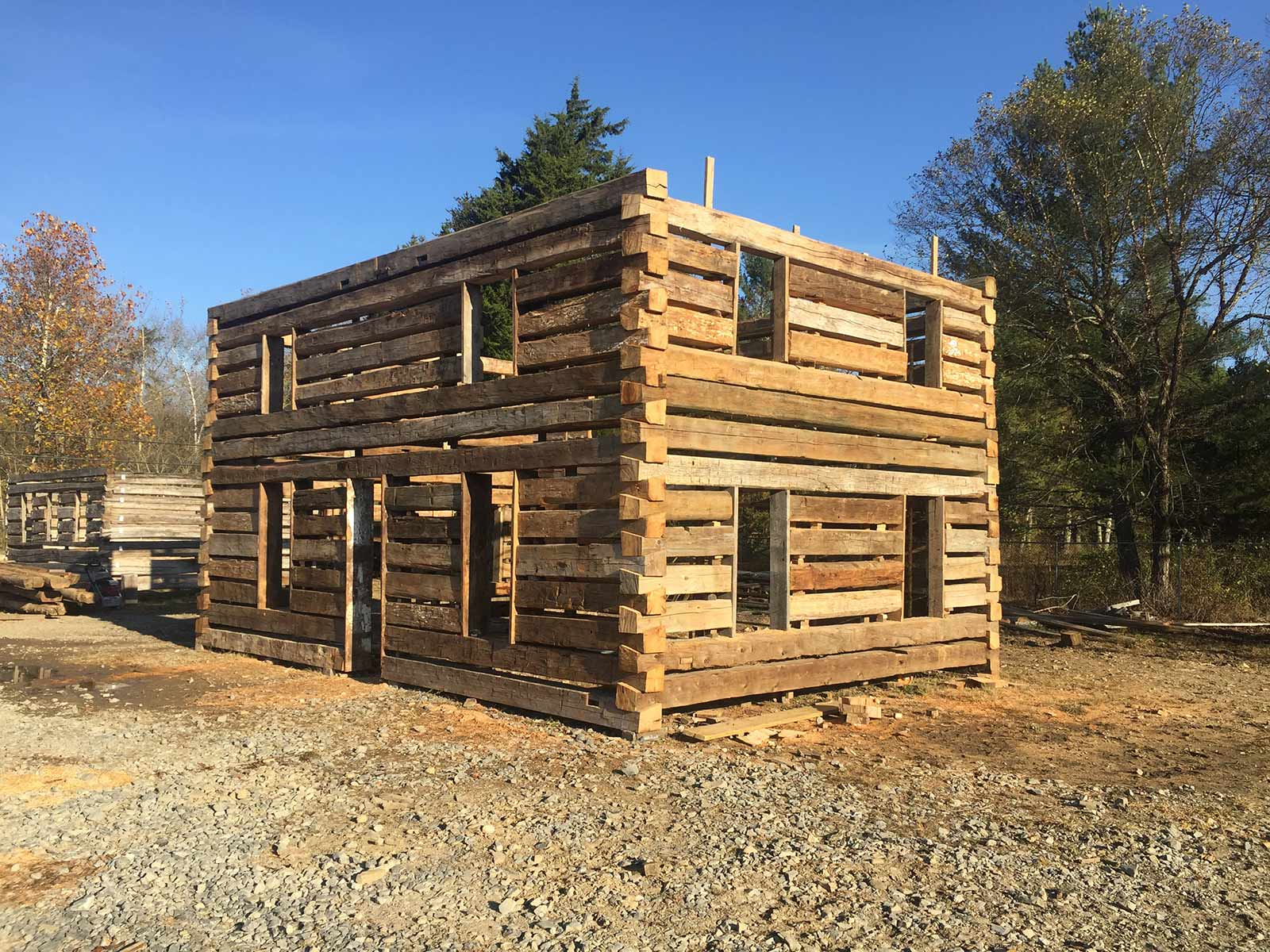 Antique structures barnwood living for Wood barn construction